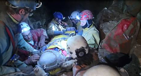Rescuers move injured cave explorer
