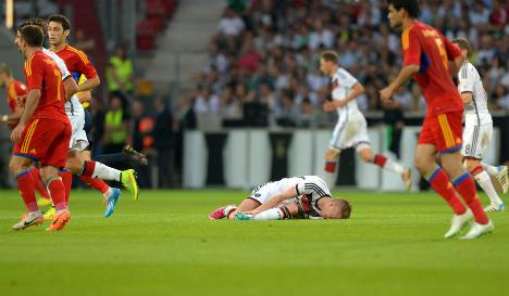 Reus injury dampens Germany's six-goal romp