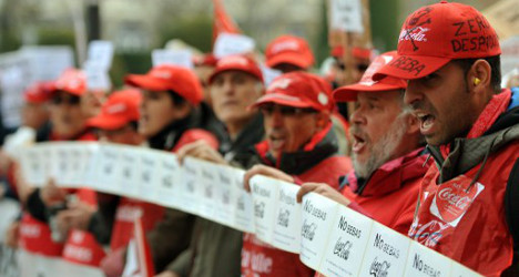 Spain forces Coke to rehire wronged workers