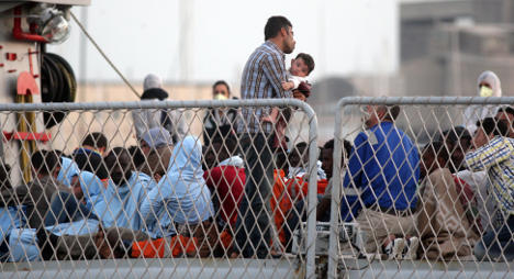 'Italy bears a heavy burden with migrants'