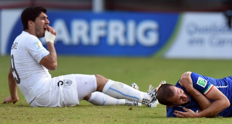 Suarez banned after taking bite out of Italy