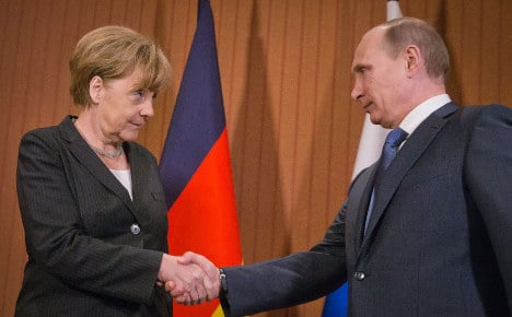Merkel and Putin talk Ukraine in Normandy