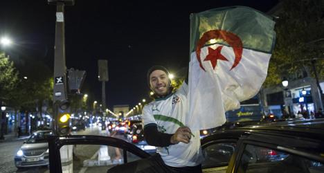 Jubilant Algeria fans take over Champs-Elysées