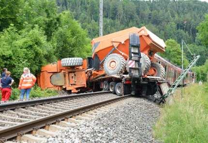 Regional train hits truck, 33 injured