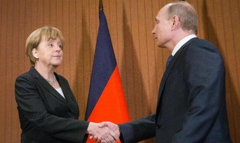 Merkel, Putin agree on international crash probe