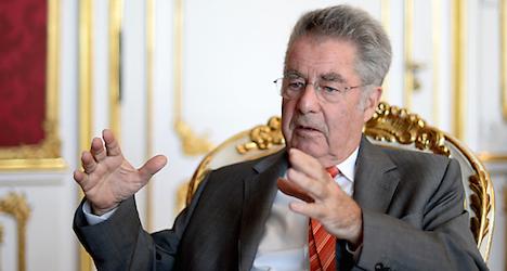 Fischer defends Putin's Austrian visit