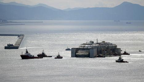 Costa Concordia reaches final dock in Genoa