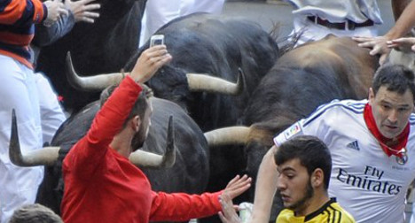 Risky business: Man snaps bull run selfie