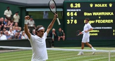 Federer struggles past Wawrinka in epic duel