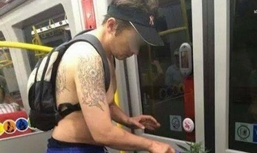 Topless metro rider rides 'green'