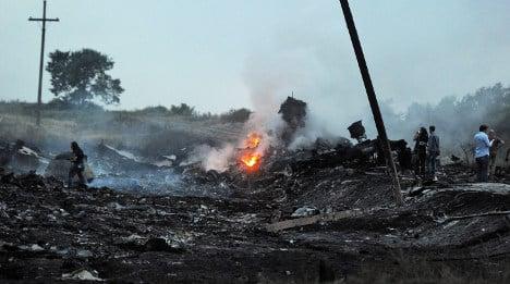 France demands probe into Malaysian jet crash