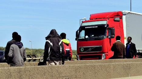 Migrants use tunnel rail chaos to make bid for UK