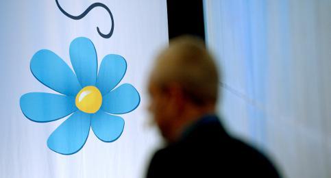 Sweden Democrat spray-paints passerby