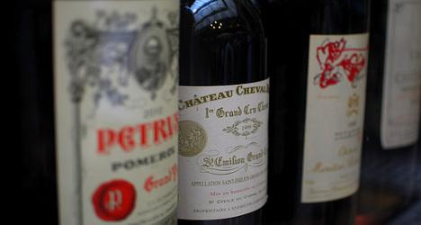 French truck spills 18,000 bottles of fine wine