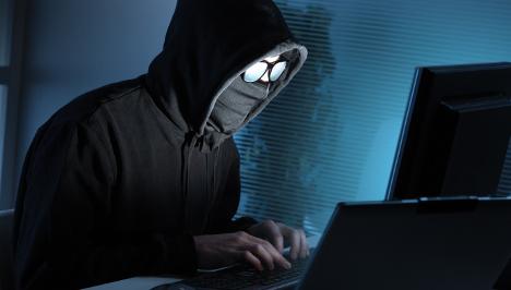 Teen arrested for bank hack crime