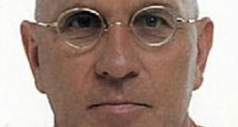 Police identify body of banker killing suspect