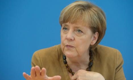 Merkel tells Putin to stop sending arms to Ukraine
