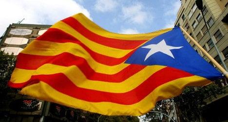 Spanish police steal Catalan separatist flag