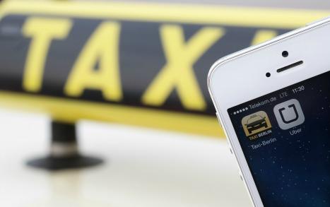 Berlin bans Uber app, taxis rejoice