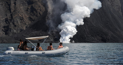 Tourists flock to Italy's erupting volcano