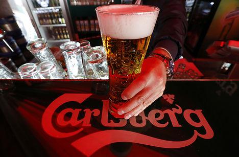 Carlsberg lowers outlook on fall in Russian sales