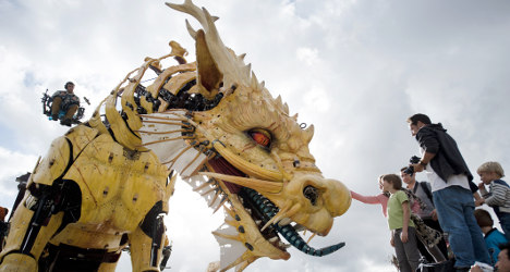 IN IMAGES: Artists unveil mechanical dragon