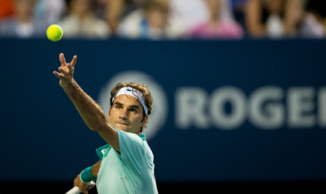 Federer cruises past Lopez to book final spot