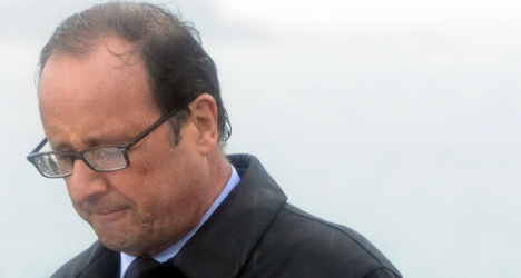 'It's a lie and it hurts me': Hollande responds