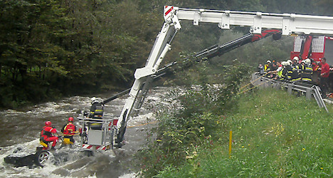 Porsche found in river with body at wheel