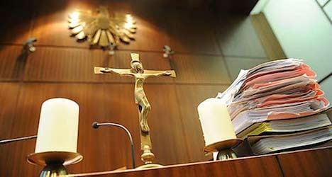 Nine hooligans in court over racist attack