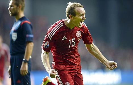 Denmark rides header to victory over Armenia