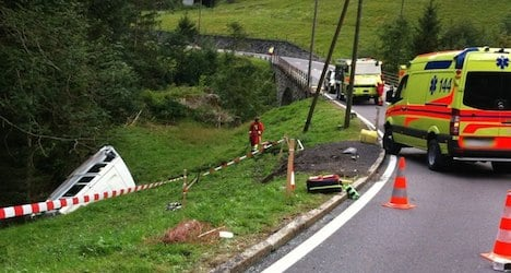 Baby and 16 men injured after bus flips off road