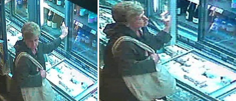 Pensioner snapped stealing champagne