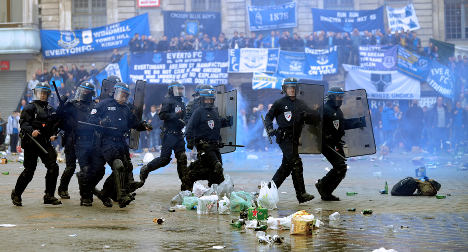 Lille: French cops clash with English football fans