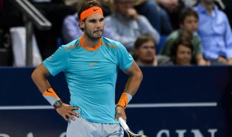 Nadal calls time as Federer advances