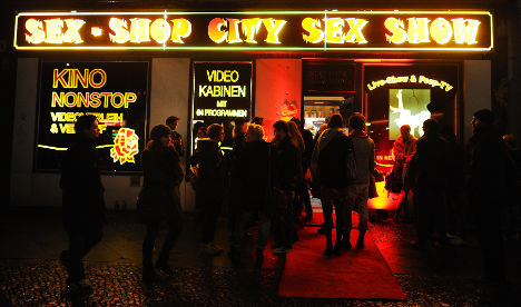 Two men charged after sex shop tantrum
