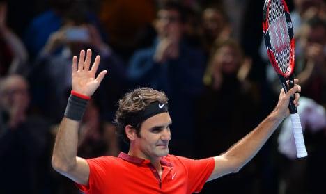 Federer survives thriller to earn Djokovic clash