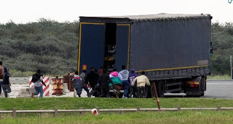 Two migrants burn to death in back of truck