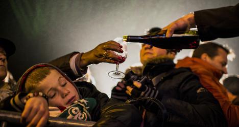 Wine-lovers get taste of 2014 Beaujolais Nouveau