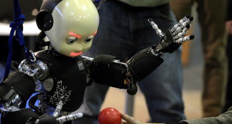 New wave robots strut stuff at Madrid expo
