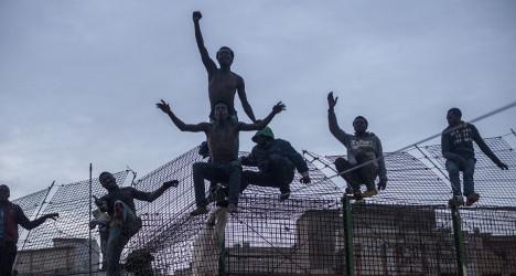 600 migrants storm Spain's African border