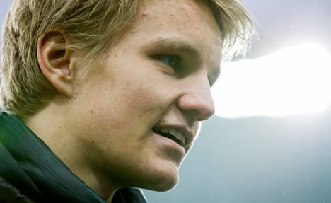 Martin Odegaard trains with Liverpool