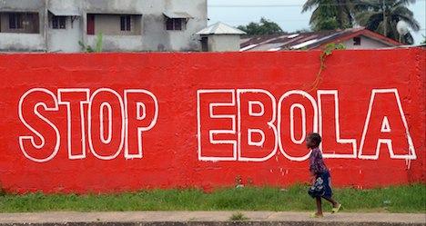 WHO downplays Ebola vaccine trial suspension