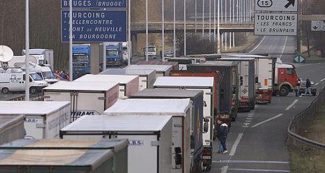 Truckers lift roadblock near Paris