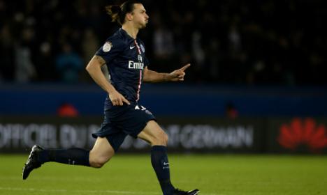 Ibrahimovic brace takes PSG top