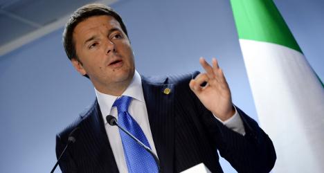 Renzi toughens law after Rome corruption scandal