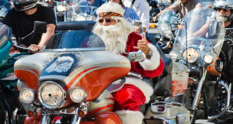 Santa bikers ride through Paris for orphans
