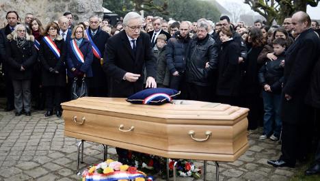 'Forgotten' victim of Paris attacks laid to rest