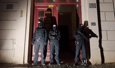 Police raid suspected Islamists' homes