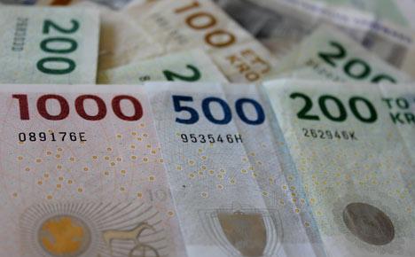 Danish central bank cuts rate as euro weakens